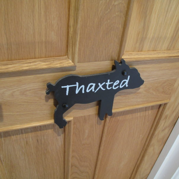 Thaxted bedroom door at Piglets Boutique B&B