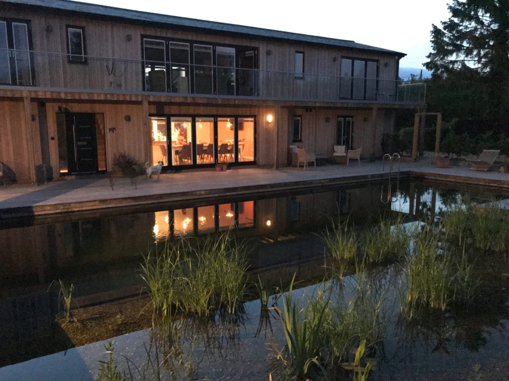 Piglets Boutique B&B across the swimming pond at night